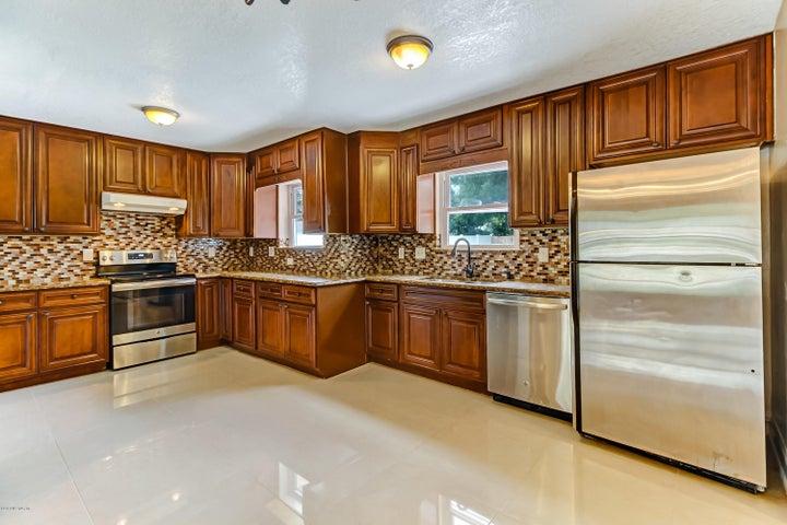 New Cabinets, Reconfigured floor plan, tile floors, stainless steel appliances, great tile back splash