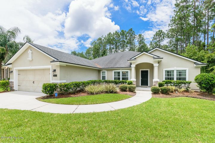 This home is inviting with nice landscaping and near the culdesac of the street