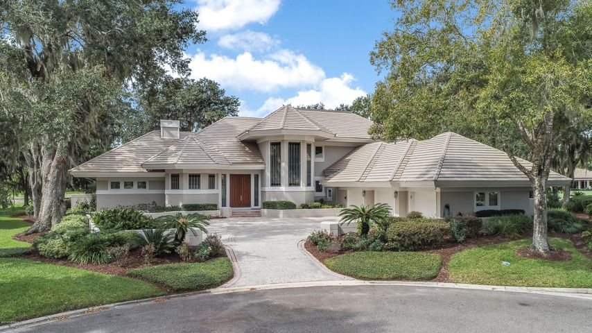 Welcome home to your spacious retreat with lake and golf course views.