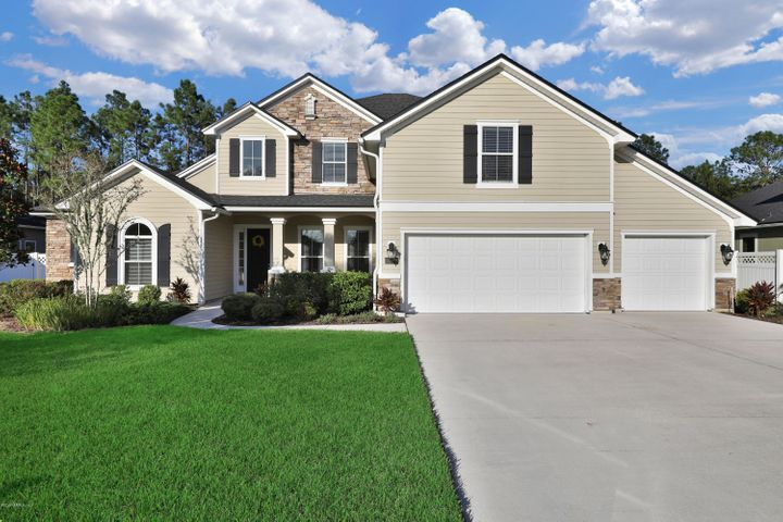 Great curb appeal with extra large driveway, plenty of parking.