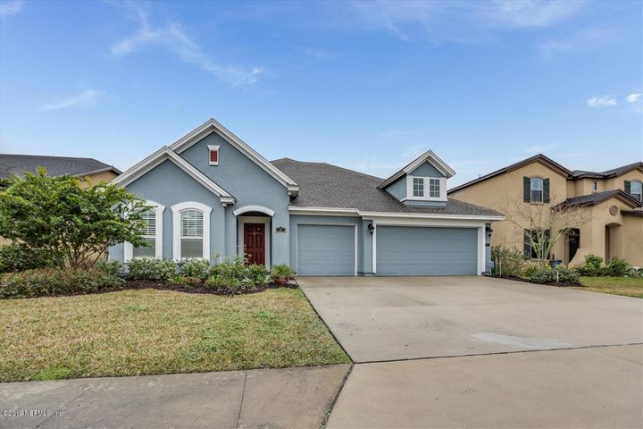 With an enviable location within sought after Nocatee this home boasts 5 BR, 4 Baths, Family Room open to Kitchen, Office, Bonus Room and Summer Kitchen on a spacious screen Lanai.