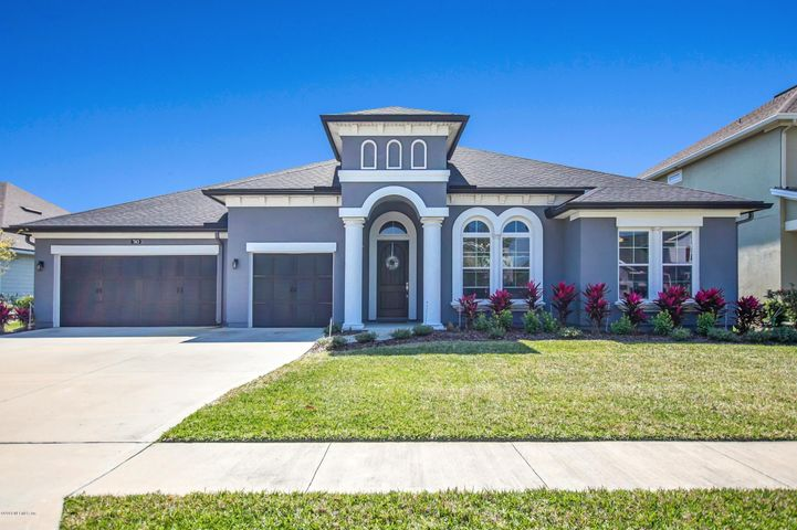 Elegant one story home in sought after Greenleaf Village with a rare 3 car garage!