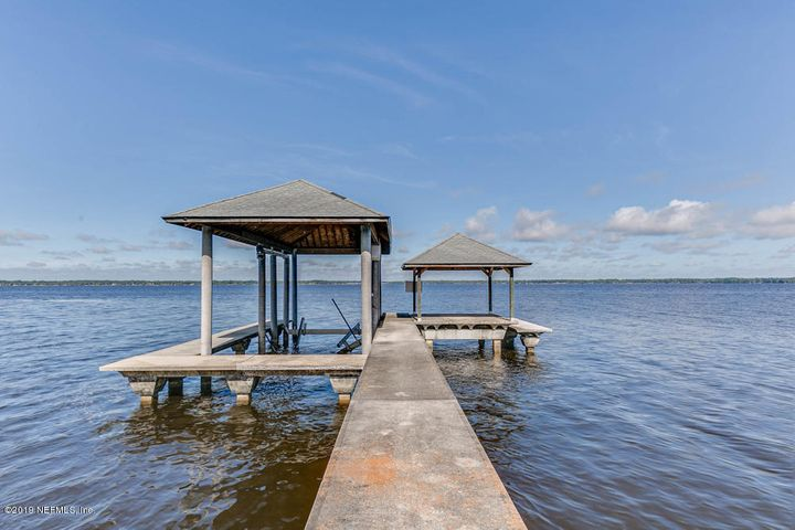 Concrete dock with covered sitting area.