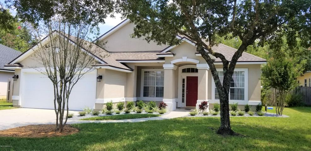 Gorgeous 4 bedroom 2 bath home with two car attached garage.