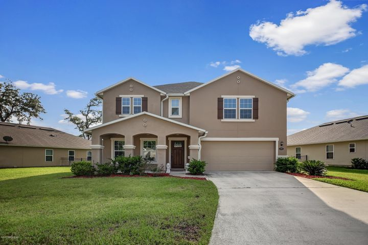 Beautiful home with stunning pond views out back, right around the corner from the fabulous amenity center