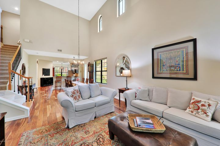 How luxurious & open this space feels w/the soaring two-story ceiling!