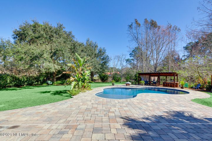 Look at the huge paver deck around the pool!