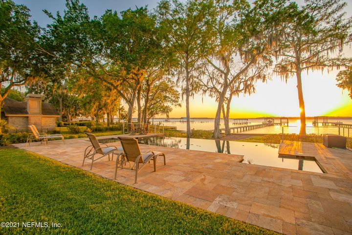 This home offers the full package for an enjoyable lifestyle....Infinity pool, spectacular lanai, dock, 5 car garage, home theatre just to get you started....