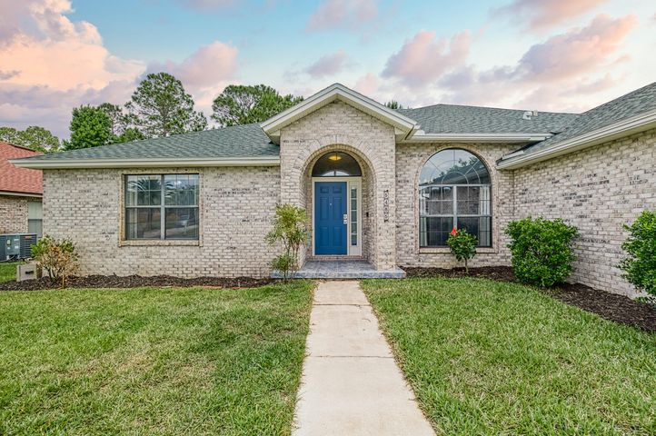 Inviting front entry - Lovely light colored brick and colorful door invite you into this large 5bd/3.5 bath home