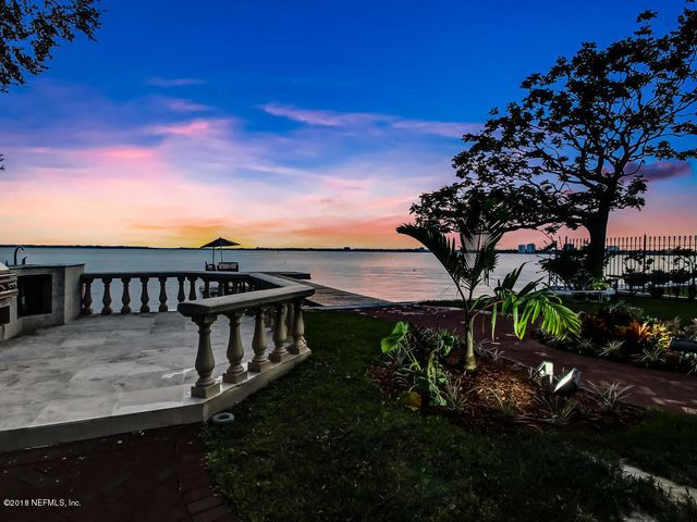 MOTIVATED SELLER will consider serious offers for this stately San Marco home. Stunning views of the Jacksonville skyline and the St. John's River.  The monolithic construction will stand the test of time and provides incredible energy efficiency.  New Spanish tile roof. Hand made wrought iron detail throughout. Granite counters, Viking appliances, Wine cellar, bar area and Travertine stone throughout. Outdoor summer kitchen with grill and new dock to the river. Two gorgeous lanai on first and second floor with new awnings.  Master suite offers its own breakfast kitchen. Loft with two bedrooms, large bonus room with bath. 5th non-conforming 2nd story bedroom is currently used as a corner library with fantastic views! Guest suite downstairs. Elevator and central vacuum. Elegance abounds! This incredible home offers so many luxurious enhancements.  Prestigious address and strolling distance to both fine San Marco shopping districts.  Home has new paint, new roof and new, expanded dock.  Spectacular river and city views!