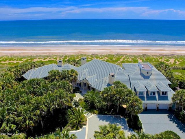 Spectacular Ocean front Oasis in Ponte Vedra Beach.This Private gated estate Home offers Complete concrete block construction and Ocean views from nearly every room .An open floor plan with full ocean views from the great room, dining room, bar, and kitchen. Walls of windows bring the ocean into full focus. A first floor master suite includes a formal seating area w/fireplace,romantic bath& 2 generous closets. Specialty area include a rich paneled study w/fireplace, roof top balcony, & separate guest apartment with kitchen.  A spectacular pool area with covered patio seating inviting  ocean views and breezes. A 2 tiered 12' high bulkhead with marine grade quality sustains the lush backyard. No Damage from Hurricane Dorian to home, dunes, or coastline.