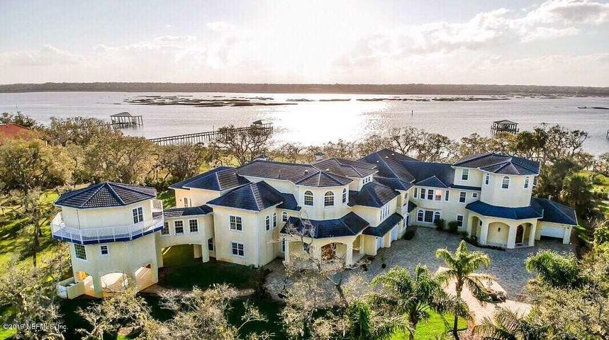 Nestled in the heart of St. Augustine Beach, this exquisite waterfront estate offers a truly unique opportunity. Set on 1.5 acres of scenic Florida beauty,this stunning home is enveloped in nature. Thoughtfully designed, views of the Intracoastal waterway can be seen from most every room. Home amenities including two elevators, a home theater, gym and sauna. 2 adjacent one acre lots are also available for a potential to own over 3.5 acres on the Intracoastal.  ICF construction!