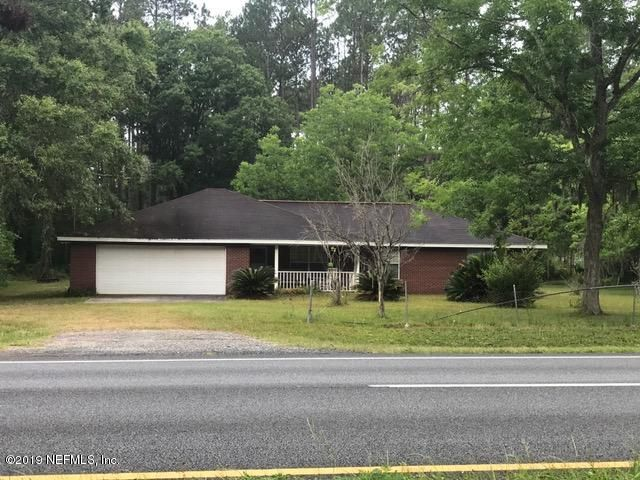This large piece of land is over 4 acres with a nice home and large shed/shop in back.  Floor plan is designed for your family.  Right on US 1.