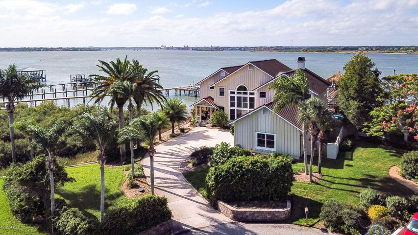 Paradise near the inlet w/breathtaking views galore!  200' Direct DEEP Water INTRACOASTAL Frontage w/ easy access to the Atlantic Ocean!  Custom built 2 story POOL home spanning over 4200 SF. Soaring ceilings and wall-to-wall glass windows is a haven for gazing at the Intracoastal, gorgeous sunsets and views of historical St Augustine skyline.   Multi-level Cypress deck w/POOL, floating dock, 6000 lb BOAT LIFT and Jet ski lift.  Private TIKI HUT at end of dock with 180 degree views equipped w/water, electric, refrigerator/sink and hammock.  Enjoy your add't LOT W/Private sandy BEACH, perfect for fishing!  Watch amazing sunsets and dolphins swim right from your spacious dock or inside from the magnificent views on both levels.  Large great room/with floor-to-ceiling fireplace.  See more... Gourmet kitchen, w/center island gas cooktop and prep sink.  First floor study w/fireplace and SALT WATER aquarium.  Spacious bedrooms w/private full size bath.  Owner's suite has separate sitting room, exercise room, and oversized shower w/separate FULL SIZE hot tub.  Private deck off the owner's suite offering stunning views.  Home was custom builder, John Hardy's former private home.  This home has it all!  Beautiful landscape, additional lot w/private BEACH, just under an acre!  Walk to restaurants, Vilano Town Center, Beach....great Location.