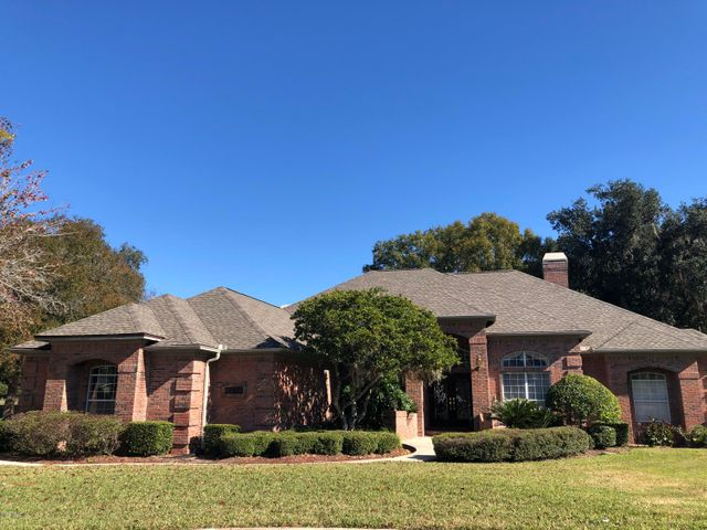EXCELLENT OPPORTUNITY TO LIVE IN A GATED COMMUNITY IN A ALL BRICK POOL HOME ON A NICELY TREED, LARGE LOT IN ORANGE PARK COUNTRY CLUB.  HOME IS LOADED WITH UPGRADES AND READY FOR A NEW FAMILY.HOME NEEDS SOME UPDATING BUT ABSOLUTELY EXCELLENT BONES. PRICED BELOW CURRENT MARKET DUE TO THE UPDATING NEEDED.20,000 Decorating allowance with full price offer.POOL RESURFACED JAN 2020 NEW ROOF MAY 2019