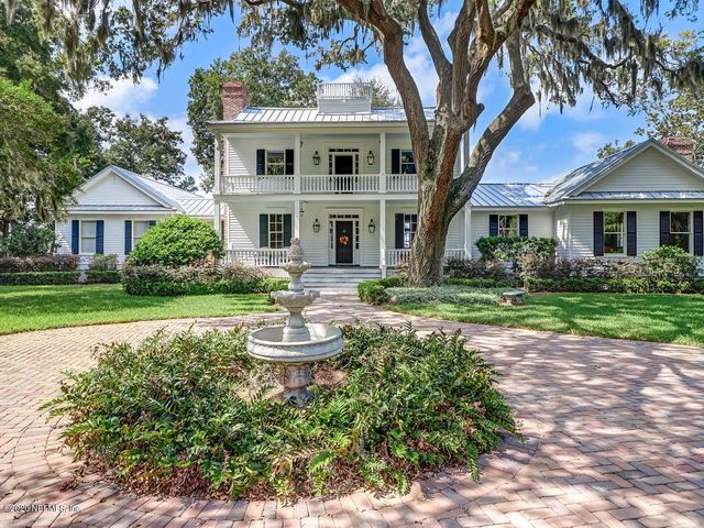 Sweeping marshfront views and stunning sunsets to literally take your breath away! Mount Hope Plantation is a beautiful home resting on a private, DEEP WATER, estate lot, with 200' of intracoastal waterfront on the south end of Amelia Island. Designed and built in 1797 by a Revolutionary War hero, the home is the oldest on the Island. Current owners are only the 4th in the home's 200+ year history. Bright and spacious, showcasing expansive marsh views from most areas of home. Wide porches provide a peaceful and serene setting, as well as a perfect entertainment setting. Loft apartment over the garage offers a perfect MIL/caregiver suite. Recent updates: addition of bulkhead, rebuilt porches, fully-restored siding, roof replacement, addition of powder bath and pool/spa. Interior ...repainted with a color palette staying true to home's period/history. Remilled heart of cypress and heart of pine floors. Abundance of storage. 4 zones. 1200-bottle capacity wine cellar. A truly special home! SEE VIDEO LINK!