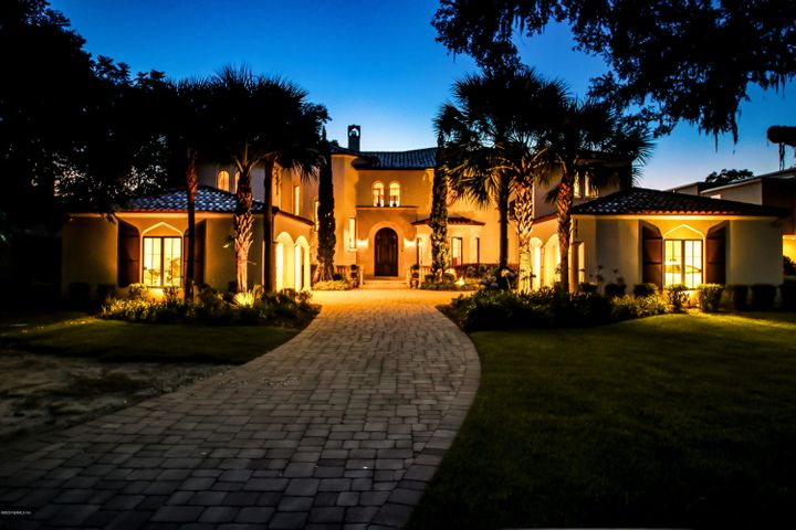 Exceptional custom-built riverfront estate on the bluffs of the St. John's River. Exquisite interior finishes & superior craftsmanship by Lendry homes for the discerning buyer who desires luxury, comfort and convenience. Grand 2-story entryway w/ vaulted wood & beam ceiling detail, custom tile inlay on floor & stairs with expansive staircase w/ iron railing and balcony.  Gourmet eat-in kitchen w/ large island, Thermador appliances, & built- in espresso machine. Two master suites w/ expansive river views, walk-in closets & spa baths. En-suite bathroom in every bedroom. Swimming pool & spa, 2 covered patios overlooking the river. Theater room, 12' ceilings, pre-designed elevator shaft, smart-panel, seamless gutters, laundry room on both floor, cedar closets, 4 car garage and more.