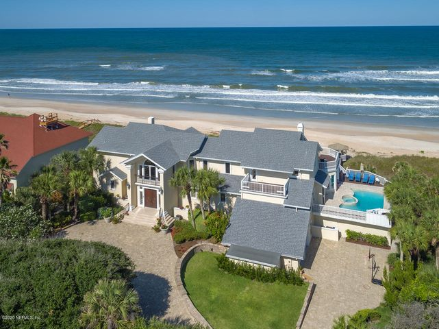 Welcome to this 3-story oceanfront oasis, nestled high on the bluff with expansive views of the Atlantic Ocean. Luxury finishes coupled with functionality make this the perfect home for everyday living on the beach. Excellent and flexible floor plan includes, living/dining combo with soaring ceilings, large owner's suite, study with custom built-ins, in-home gym, cabana room with sit down bar off of pool, guest quarters with separate kitchen which is ideal for live-in nanny or in-laws. Expansive verandas and balconies on both sides to maximize views of both the Atlantic and Guana preserve. Sparkling pool to relax and enjoy the views. Lush landscaping offers privacy. Spectacular must-see home!