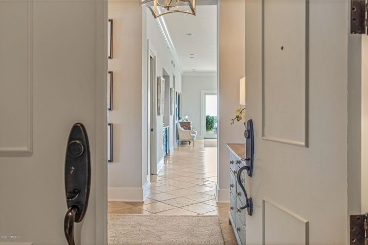Step into this fully remodeled penthouse home and you will immediately feel the tranquility and sophistication that this waterfront masterpiece will evoke. The stress of the day simply fades away when you are met with the splendor of the panoramic views of the intracoastal waterway and the warmth of the natural light from the endless walls of windows and glass doors. The renovation gives you a vast, open kitchen, living and dining area. Carefully curated with top of the line materials and finishes by a renowned interior designer. It is easy to understand why these penthouses are rarely available, there are only 2 of these east corner homes in the building. 3 balconies total 795 sq. ft to take in the breeze both east and south. The most discerning of chefs will be impressed with this well-equipped kitchen. Custom cabinetry engineered by a craftsman includes, a 5' x 15' island with large farm sink, Waterstone faucet, quartz tops along with a Wolf gas cooktop and custom hood ,KitchenAid double ovens , Sub-Zero refrigerator, Asko dishwasher , built in Miele coffee machine , KitchenAid wine cooler, double Uline refrigerated  drawers and ice-maker. The separate office/den area is off the main living and provides a quiet alcove to read, work or watch your favorite tv show. Master suite is your own personal sanctuary with its own private balcony, sweeping views and a spacious spa inspired bath with double vanities, free standing tub, huge walk in shower and towel warmer. An extensive custom walk in closet includes an island with drawers and shelving by same craftsman.  All guest rooms are over sized complete with remodeled ensuite baths. A 50-foot boat slip is available for your yacht within viewing distance of the balcony for separate purchase   $50,000.  This is the ultimate oasis within the gates of Marina San Pablo, a secured luxury building with amenities that include club facilities, lap pool, fitness center, minutes from Jax beaches, Mayo clinic, St. Johns Town Center.