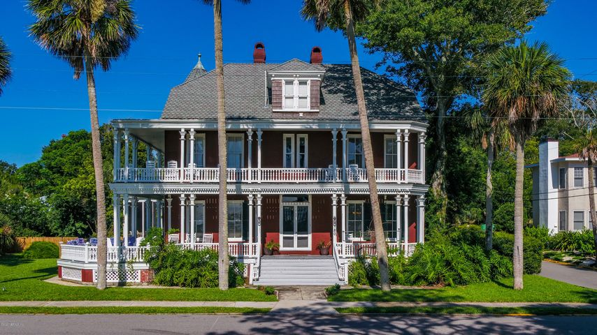 SEE VIDEO. First time on the market, this stunning historic waterfront landmark St Augustine property is ready for the next generation of stewards! Built in the late 1890s, it is an example of Second Empire Victorian architecture complete with an octagon turret room. Red brick veneer with white trim, fish-scale shingle roofs and double wrap around porches make this a timeless classic. Two parcels totalling .86 acres are included, one with the home and carriage and guest house units and one with the docks and water access. Almost all of the original features remain with numerous fireplaces, oversized wavy glass windows, claw foot tub and a hidden apartment for guests or caregivers. If you have been looking for a sturdy and large stewardship home in Historic St. Augustine, this one is for you.