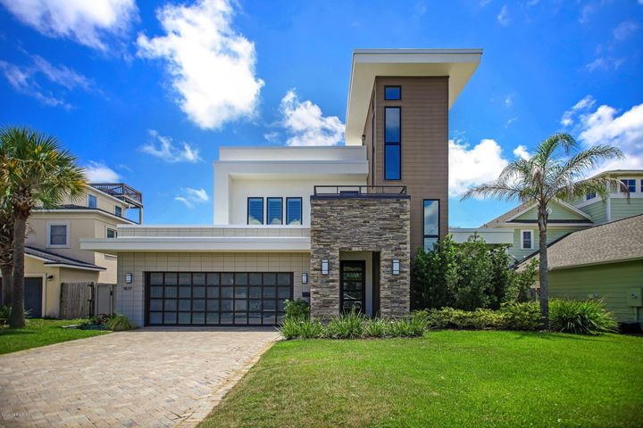Now is your chance to own a one of a kind, elegant and contemporary home in Atlantic Beach. Situated just a block to the ocean, this 2016 home is truly amazing!  Local architect Marc Macco designed the contemporary beauty with clean lines and sleek elements. Aria Homes was the builder and they incorporated novel design elements. The home boasts ultra sleek bathrooms with custom fixtures and tile work. The kitchen has extensive options of suspended cabinets with frosted doors, large prep island with quartz counters, and double sinks. Dark wood floors give this home true contrast and style.  The backyard is a private oasis with custom pool by John Garner and  summer kitchen. Three balconies including the 3rd floor eagle's nest round out the exterior space. This home is magnificent!