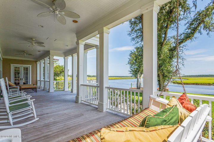 8046sf main home, 5 beds/7ba & 2 half baths w/approx 1000 sf detached guest home (2 beds/1 ba) located on approx 2+acre estate. 2 separate docks with DEEP water access. Breathtaking view of the Timucuan Ecological & Historical Florida 46,000 acre pristine Preserve, hosting the Nassau River & its Salt Marsh estuary. Covered porches & balconies afford fresh breezes & private settings. Huge gourmet kitchen equipped to handle large gatherings. Featuring exquisite mill work & hardwood floors, elevator, 2 separate offices, up & downstairs laundry, oversized exercise & bonus rooms, 6 oversized garage bays. Breathtaking sunrise to sunset views from your backyard!  High & dry property w/ no flood damage. Minutes to Jax Int'l Airport & short boat ride to Amelia Island. Lot 124 available separately.