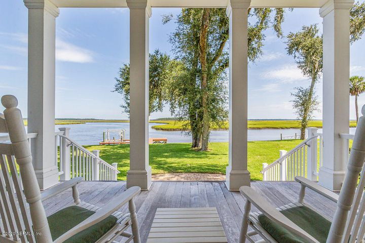 Approx 8046sf main home, 7 beds/7ba & 2 half baths with approx 1000 sf detached guest home (2 beds/1 ba) located on just under 3 acres with 500' concrete bulkhead, 2 separate docks on DEEP water access with view of breathtaking Timucuan Ecological & Historical Florida 46,000 acre pristine Preserve hosting the Nassau River & its Salt Marsh estuary. Property consists of 3 separate parcels and 2 are still buildable for riverfront homes. Gourmet kitchen, elevator, 2 offices, up & downstairs laundry, 6 oversized garage bays, two extra bonus rooms; too much to list! Minutes to Jax Int'l Airport & short boat ride to Amelia Island for fine dining, golf and boutique shopping.