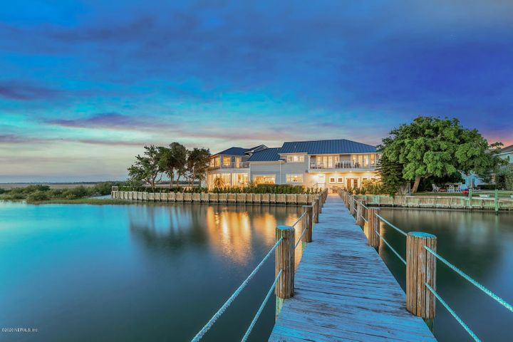 This COMPLETELY RENOVATED, peaceful oasis sits on 1.73 acres directly on the Intracoastal Waterway.  The architectural details of the Andrew Howard designed modern coastal interior are stunning. This home has been featured in Coastal Living Magazine & was featured on the  cover of Kiplinger Magazine in 2019. From the incredible statement ceilings to the terra cotta glazed backsplash to the custom kitchen hardware, this home has it all. The kitchen is magnificent and features custom cabinetry and a walk in pantry. There are 2 renovated master suites positioned to leverage the incredible water views and the master baths are spectacular!  Set sail from your very own dock & be in the open ocean waters in minutes or take a quick walk and enjoy your day on the beach. Come live the ''Salt Life'!