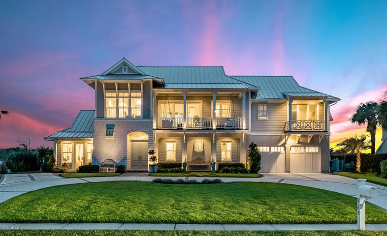 Built with a penchant for detail, this custom beach home highlights the gorgeous surrounding landscape, with Ocean sunrises to the east / Guana Preserve sunsets to the west, while seamlessly integrating that beauty throughout. Featuring a neutral coastal palette, every aspect of this home was thoughtfully designed by the seller, owner of Nesting Place Interiors and built by Heritage Homes. The ethereal backyard offers Al Fresco dining with tranquil views, making it the ideal backdrop for casual and formal gatherings. Spend your days transitioning from morning cups of coffee on the front balcony swing to a nightly glass of wine on the back porch complete with summer kitchen and fireplace. A masterpiece of design and craftsmanship, this home offers sophisticated coastal luxury at its finest.
