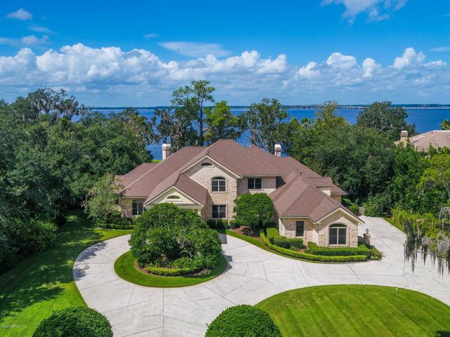 Elegant,Timeless,Florida Lifestyle at its finest. The home is perfectly positioned in Admirals Inlet and offers panoramic & unobstructed views of the St.Johns River. Generous soaring ceilings plus an abundance of windows allow for a natural flow of light throughout.  Almost every room has views of the river, with sprawling grounds accompained by a 20 X 40' pool.  The master suite is down plus a study & one additional bedroom. Every bedroom upstairs is a suite with large closets.3 upstairs bedrooms have access to the riverfront balcony.  The main living areas include a butlers pantry off the dining room plus a wet bar room off the family room. The kitchen offers an oversized chefs gas cooktop with a grill and flat top with a commercial fan. Elegant timeless florida lifestyle at its finest.