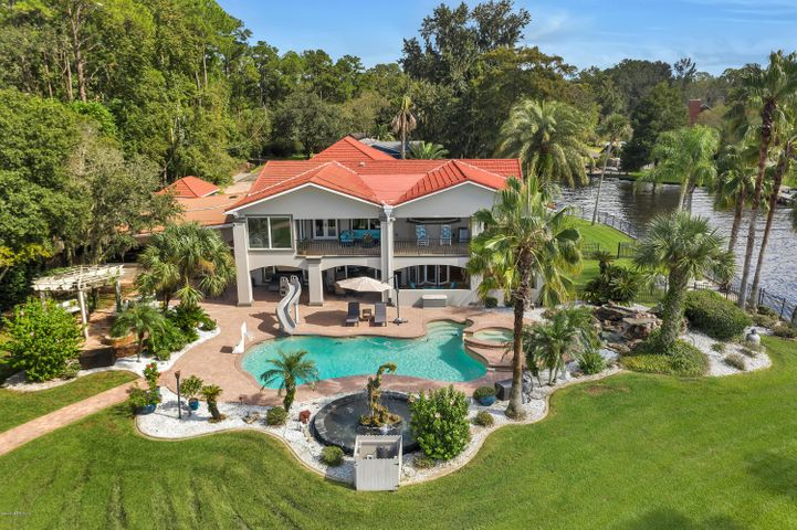 Expansive river views: approx 458 of bulkhead (188 along the St. Johns River & 270 along Deep Bottom Creek) - 330 foot dock with 2 covered lifts, 1 open lift and a 2nd floor deck. Home features include: oversized kitchen with 2 accordion doors opening into the outdoor kitchen and lanai; built-ins throughout; private owners retreat with sitting area, 2 closets, steam shower, jetted tub looking out into the river, and private wrap around balcony with hot tub;  home gym; large office with great views of the river; smaller office; theater; exterior half bath; generator; built-in speaker system (Sonos); 3 exterior fountains; detached storage shed; another detached building that could be used as a nanny room; security camera; electric gate; and so much more. Be sure to watch the 3D Virtual Tour