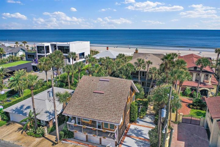 Enter through the gates of this iconic Atlantic Beach Oceanfront Estate. Large wraparound porch welcomes you to the main house. Enter stained glass front door to an open marble floored foyer. 1920's era oceanfront charm includes original hardwood floors, bead board walls & ceilings, natural wood finish woodwork & trim throughout. Upgrades & improvements offer every modern convenience without whitewashing the vintage beach character. Upstairs master suite enclave includes spa bath connecting to private office & fitness room then leads to 2nd story deck. 3 additional on-suite bedrooms in main house. Three level guest house w/1,536 sq. ft,  3 bedrooms, 2 baths, 2 decks, & 3 car garage, studio/workshop & powder room on 1st level. Nestled between houses find a charming Cabana/Studio w/bathroom.