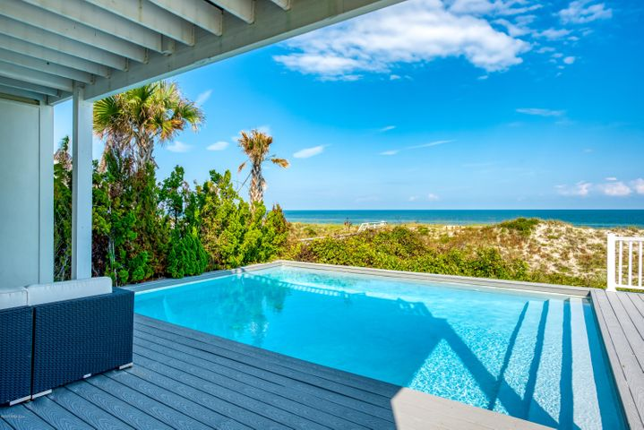 Some of the most stunning ocean views are focal in this sleek almost new contemporary. Simplicity, subtle sophistication, and deliberate clean lines create a beautiful family home on one of the prettiest beaches in the state, but also an incredible investment opportunity. With the pool, seven bedrooms, and a locale that is within walking distance to a myriad of popular restaurants, this oceanfront home elevates the possibilities to maximize short term rental income.The relationship between the indoors and outdoors is augmented by extensive vistas from multiple vantage points, and the absence of color in finishes, such as the white quartz in both the kitchen and baths, keep the space light and bright. Decks on each level are accessed by a wall of sliding doors, allowing the sounds and smells of the sea to provide the ultimate oceanfront experience. This open floor plan with a chef's kitchen provides ample space for entertaining. Beyond the beauty of the ocean, are the stars are observable from the master, with its unobstructed vantage point. Gorgeous ocean sunrises, intracoastal sunsets, and a pool lit for a dramatic presentation blend the perfect balance of luxury and tranquility. Rental history available upon request....