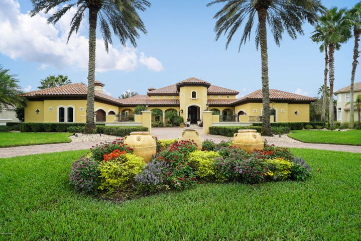 """Welcome to 105 Hickory Hill Dr in St. Augustine, Florida. Located in the Palencia neighborhood, this modern-day Tuscany style home is sure to WOW you. From the moment you step foot on the property you can tell this home has been meticulously maintained and cared for. The sophisticated architectural exterior design is elegant, yet timeless. Owners have spared no expense using top rated materials and products throughout the home, including a quality built concrete block/concrete construction of walls and foundation. Entering through the double glass doors, you are greeted with tall ceilings and large open spaces. Beautiful pillars add elegance to the entry way. With a family room, living room, and formal dinning room this home has all the space needed for special gatherings. The kitchen is a chef's dream featuring, GE Monogram appliances, 48"""" cabinets, granite countertops, large island, and a wine fridge. Also included in the kitchen is a professionally designed, true wine cellar. This wine cellar is professionally designed with moisture and temperature control, and can hold 400+ wine bottles. The master suite is spacious and features its own fireplace, seating area good for reading, and a huge walk in closet. The fabulous master bathroom is designed with relaxation in mind. With large pillars and a claw foot tub, you are sure to find your Zen in this room. There are four other bedrooms that all have their own bathroom. Another fabulous room in this home is the office, which has been designed by a professional for music listening. It features acoustic sound control and has its own private garden with a terrace and fountain. The large windows all around bring in the natural light and give you a perfect view of the lush landscaping surrounding the home. All light fixtures are high end. There are muiltiple locations on the ceiling that have exquisite details, hand painted by a local artist. You can enjoy fantastic entertaining in the backyard oasis. Featuring an outdoor """
