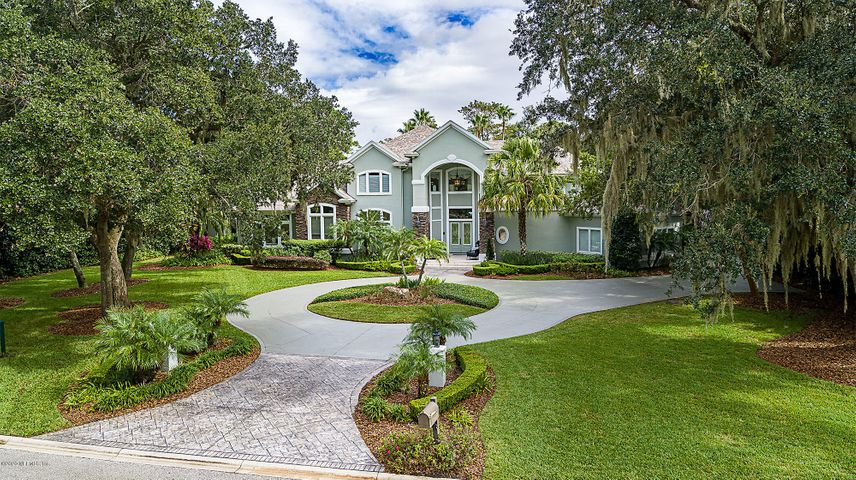 From the moment you step foot on the property you know this is Special! This estate is nestled on 1.09 acres of lagoon front bliss overlooking the 2nd fairway of TPC's Stadium Course. Recent renovations include a 765 sq. ft. 1st floor guest suite with a family room and poolside lanai, a new roof, and an incredible outdoor living area with a pool/hot tub and covered dock. Enjoy this expansive living with doors that open to bring the outside in. A Transitional design that provides private spaces that blend with gathering spaces. The updated kitchen has a hidden Butler's pantry with an oven and lotsof storage. Gorgeous poolside owner's suite with a spacious marble bath and grand dressing room. Second floor balcony with a spiral staircase to poolside living. A lifestyle not to be missed!