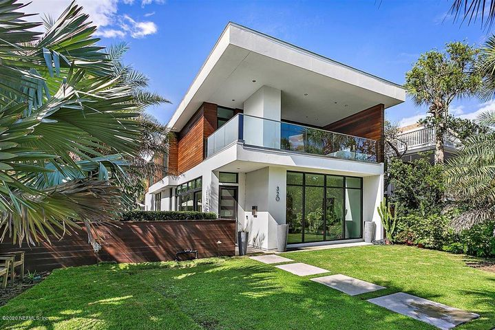 This modern masterpiece with clean lines and a sophisticated design is a rare gem located in the ''sweet spot'' of Old Atlantic Beach on a sought-after corner lot with southern exposure that runs between the block of Beach and Ocean Blvd. It sits across the street from the ocean and a 3 block stroll to Town Center. Built in 2016 with quality throughout. Features include: English oak wide plank wood floors, electric shades and floor to ceiling glass walls, custom, sleek cabinetry and built-ins. Exterior Brazilian hardwood and stucco. 1st floor with 20' sliding glass wall that opens to private, gated courtyard with heated pool & swim up bar. Expansive/open kitchen/great room. Kitchen has oversized, marble island, wolf gas stove, sub-zero ref. and separate freezer.  Stunning modern fixtures over dining area & great room with linear F.P/T.V. wall. Downstairs guest suite, pantry, and office. Lavish owner's suite w/ocean views, wonderful custom walk in & built in dresser, covered balcony w/fireplace. 2 other ensuite bedrooms with balconies and 2nd family room & large laundry room up.