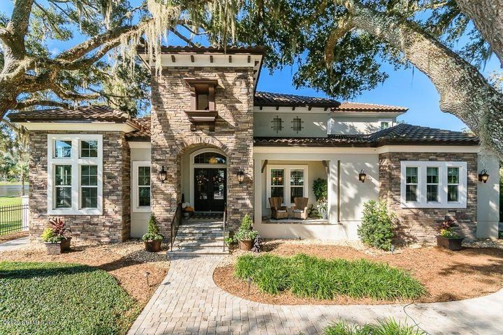 2 year old custom home by Arthur Rutenberg  on the Intracoastal Waterway! This home epitomizes style. Open island- designed kitchen and adjoining full bar give any gathering elegance .  Pocketing sliding doors open to the amazing screened pool area that provides special ICW views. The boat house includes 2 lifts and great space for relaxing. Wood-style tile floors, neutral earth colors inside & out. Master suite, office/5th br and a guest suite are downstairs, plus a huge craft/laundry room storage.  The 2nd floor provides spacious bedrooms, media room, plus party room with bar and spacious balcony.   Slab elevation looks down on surges or recent ''King Tides''  Plenty of space for boat trailers and toys.