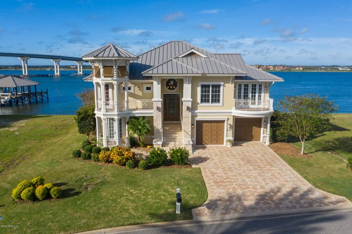 Nestled along the banks of the Intracoastal Waterway, each day begins with views of the sunrise across the marsh and ends with magnificent sunsets! This ''Island House'' was designed to capture up front coastal water living. Located in North River Island, a gated, waterfront community just a few blocks from the beach that offers a short boat ride to offshore adventures or a quick trip over to the historic St. Augustine Bayfront! Coveted deep water access off the dock with covered area. Step inside from the impressive elevated entrance & take a half flight of stairs up to the main living area where you will enjoy the family room & wet bar perfectly designed for comfortable living & entertaining on a grand or intimate scale. The wall of windows & doors to the west bring in the Intracoastal views & draws you out to the terrace where you'll want to spend evenings dining al fresco with the sunset as your backdrop, watching the dolphins & waterbirds play & the boats pass by. Back inside if you must, the fireplace serves as an inviting focal point for the room & keeps you cozy on those cool fall nights. The spacious kitchen overlooks the family room & the chef will enjoy the Thermador gas range, double ovens, great cabinet space, a large prep island with room to seat a few while the formal dining room & office are off to the side. The luxurious front-to-back master wing is privately placed & captures its own serene water views & 2 balconies. The bedroom offers a sunny sitting area, fireplace, & oversized closets while the master bath rivals the finest of spas w\split vanities, Roman tub & oversized shower. The rotunda connects each side & level & taking the elevator down keeps things easy. The 1st floor offers 3 en-suite bedrooms, 1/2 bath, utility room, & a gathering room that spills out onto the poolside deck that extends over the seawall to maximize your waterfront space. It's a waterfront paradise with a private, a shared deep-water dock with two boat lifts. Welcome Ho
