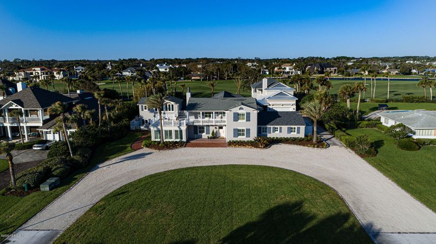 A rare opportunity to own 140' on the 3rd fairway of the PV Inn & Club's Ocean Course with beach access across the street. This home was renovated with a spectacular addition in 2011 and a new 2,128 sf guest house in 2017. The outdoor living area is expansive with a large pool/hot tub, firepit, multiple covered lanais with seating areas, fireplace, and summer kitchen. The main house has 5 bedrooms/5 baths & 2 half baths. Architectural features include a floating staircase, designer beams and wide open floor plan. The Owner's suite is an entire wing of the home with 2 floors. The 2nd floor opens to a deck with ocean views. The guest house has a family room, kitchen, 2 bedrooms, 2 baths, 1 half bath & a 2nd floor balcony overlooking the pool. Encompassed on 0.84 acres and steps to the sand