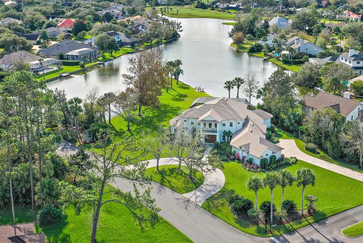 Welcome to this spectacular lakefront home in the heart of Sawgrass CC. Situated on one of the largest lots in Sawgrass, this updated 4-bedroom home takes in amazing southerly views of the lake and golf course beyond. The grand entry opens to the living areas downstairs that look out to the pool deck and lake. The chef of the house will enjoy the large kitchen including top of the line Viking appliances and gas stove-top. Dinners can be formal in the dining room or more casual in the breakfast area or on the screened lanai out back. There is plenty of room to spread out with 4 bedrooms plus an upstairs bonus area and sun room along with a private home office. The 3-car garage has tons of storage space and room for a golf cart too! Lot's of features in the d