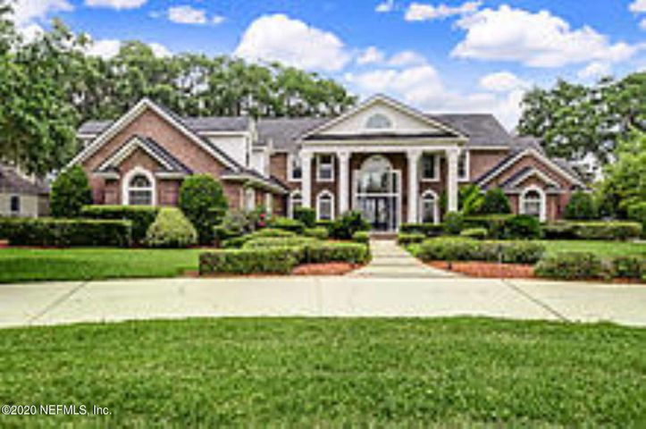 The St. Johns River meanders past this former home site of Harriet Beecher Stowe that is now a 7,500 SqFt Southern colonial all-brick with open floor plan and large windows for viewing the home's many river-facing rooms and nestled next to the historic Stowe Oak.The two-story home features 20' foyer leading to formal living room, dining room, and office along with first-floor family room, billiards room, breakfast area, gourmet kitchen, 2 full baths, master suite with full bath, his and hers walk-in closets and bay window sitting area.  The upstairs has large bonus room, 4 bedrooms and 4 full baths and great closet space.The 39' x 18' covered lanai has ample grilling and lounging area and overlooks pool with marbled waterfalls to complete gracious living