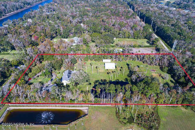An idyllic setting combined with unrivaled land versatility creates this nature and horse lovers dream located just minutes from the sands of Ponte Vedra Beach. Consisting of two separately deeded parcels, this 5 acre offering is one that is unheard of in close proximity to coastal areas of the United States. The northernmost parcel consists of 4 acres of land with a home that was renovated from the studs out in 1993. This home offers two bedrooms and two full baths with 2556 sq ft of conditioned space.  In the back of this property lies a barn ready for up to 6 horse stalls, a paddock, and a pond positioned on the southern side of the parcel.  The home on the southern one acre parcel was built in 2000, consisting of 4 bedrooms and 2 full baths with 2128 sq ft of living space.