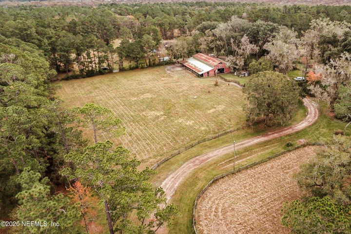 223+ Beautiful acres in the small country town of Callahan. If you are looking for a place for cows, horses or to just have your farm animals then this land is perfect for you! There is a barn, multiple fields, 2 horse corals, a stocked pond, and lots of game such as wild pig, turkey, bobcat, fox, squirrels & deer to hunt. This property also has 2 homes on it. There is a mobile home and a single family home. Square footage & bed/baths are combined in listing. This property is located just minutes away from town and about 20 minutes from River City Marketplace.Additional Parcel #371N25296C00230010.