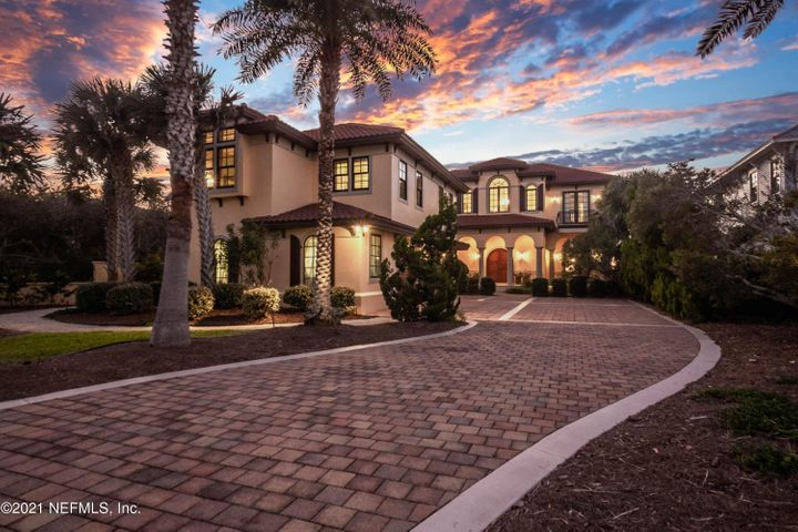 Astonishing Waterfront Estate Home on Intracoastal Waterway with deepwater dock,boat house, elevator, and attached guest wing.This stunning 5BR 5.5 BA pool home designed by Florez & Florez, completed in 2007,sits on over an acre, built secure with concrete block, tile roof, impact windows/doors,security system and cameras.The expansive open floor plan allows for extraordinary entertaining with French doors leading to over 2,000 sqft of covered porches, summer kitchen, screened heated pool.Mahogany front doors lead you to the beginning of this Intracoastal Paradise.The first level flooring is Jerusalem stone throughout.Elegant molding around each detailed entrance as you stroll from room to room with 20ft ceilings ,windows and doors all having vast open water views. Billiard Room with coffered ceiling,granite wet bar,copper sink,wine cooler, features two wood pocket doors for added privacy.Elegant living room has Vision Art TV over fireplace with Tripp Harrison artwork. Unique fireplace is imported Italian marble with gas logs.Chef's kitchen with ample storage, DCS 5 burner gas range w/griddle, double ovens,Kitchen Aid ice maker, Fisher&Paykel 2 drawer dishwasher, Built in GE Monogram refrigerator.Guest Wing includes a sitting area,2 bedrooms, full bathroom and kitchenette. Brazilian Cherry wood flooring up the freestanding curved staircase to the 2nd floor. Convenient elevator complete with Red Onyx floors and telephone.Upstairs has His/Hers connecting Master Suites. Each with French doors leading to the Travertine balcony with breathtaking views of the IntracoastalSurround sound through the entire home and pool area. 500 Ft. Dock includes a covered boathouse and (2) 7,000 lb. boat lifts. Exterior fire gas pit with ample seating.The home has a Caterpillar generator, Lightning Rod system on the roof, and electronic entrance gate with keypad.Public Beach access is walking distance just south of the home. Buyer to verify all measurements.