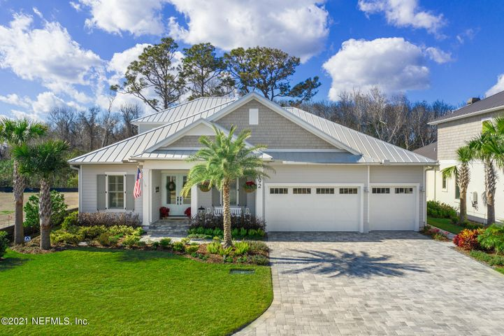 """The Palms at Old Ponte Vedra!  Last chance to live in this sold out community of only 21 homes.  A short walk to the Beach and The PV Lodge & Club.  This Coastal inspired home backs up to the Conservation Area & was built in 2019.  5 BR, 4.5 Baths, a Study, Dining Room, Butler's Pantry, walk-in Pantry, Sitting area in Owner's Suite, 2nd FL Guest Suite w/ Gathering Room, Pool & 3-Car Garage (Floorplan under Documents tab). Casual beach living at it's best this Open Floorplan features Shaker White Cabinets in Kitchen w/ Quartz Countertops, Wood Plank floors in every room, Gas Fireplace w/ lovely surround stone, Plantation Shutters, Built-ins, Shiplap accents throughout, Wood Beams in FR, Summer Kitchen, Thermador Appliances, wine storage & ice maker. New construction! Majority of home is on the first floor with 3,451 sqft and 903 sqft on 2nd floor.  The 4th Bedroom is absolutely sun-filled and is a flexible room (23'x 17') that is positioned off the Family Room.  Perfect for a Playroom/Gameroom/Media Room or Bedroom! The Palms at Old Ponte Vedra is a Natural Gas Community and is in the wonderful St. Johns Co. School District.  Other Features of Home:  - Raised Concrete Wall construction (4 Course Stem Wall)  - 2 x 6 construction spaced at 16"""" O.C.  - Pella Proline Aluminum Clad Windows  - Coastal Architectural style w/ Galvanized Metal Roof  - Smooth Hardie Board Lap Siding  - Double front doors (Love that!)  - Pre-wired for Whole House Generator.  Concrete Pad for future generator  - Insulated Garage doors  - Tongue & Groove Lanai Ceilings  - Beams in Living Room  - Ship Lap Accents in Master Bedroom and Bathroom Ceiling, Dining Room, Stairs, Family Room, Powder Room & Bedroom #2 (recent)  - Custom Closets in Master Bedroom (recent)  - Built-ins & Fridge/Dry Bar in 2nd Floor Gathering Room (recent)  - Backyard renovation to include a 15 x 30 Pool with Sun Shelf, Shear decent fountain, Heater, Jets, extended Pool Decking, Motorized Screen on Lanai, and Fence with two """