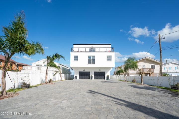 Beautifully remodeled 3 story beach house! This is ICF construction. Direct oceanfront home with 8 bedrooms and 4 bathrooms. The entire third story is an amazing 2100+ sq ft room with a large kitchen that includes a leather granite island that is over 100 sq ft. There is also a very large dining room area as well as substantial living space. As you look around this gorgeous house you will see stained concrete floors, barn wood, open rafters, white shiplapped walls, and custom tiled bathrooms. You can step outside onto three different balconies surrounding the house and depending on which one you are on you will experience beautiful views of the sunrise, sunset, Matanzas River and the ocean. You can easily accommodate groups for reunions or weddings or live in it with your large family.