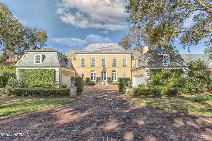 Elegant French Country Style in coveted neighborhood of Granada. Built by one of Jacksonville's most noted builders and designed by world renowned Architect, H.S.''Sprott'' Long & Associates. As you drive through the gate you will feel as though you are in a French Countryside. One of the larger lots overlooking The St Johns River.  While elegant you will find a casual and welcoming feel as soon as you enter the front door. This family has enjoyed the oversized living spaces and generously sized bedrooms (each with private bath). Fabulous terrace overlooks newer pool and river. Relax with your favorite beverage at the end of the day on the master bedroom balcony and enjoy a spectacular view of Jacksonville's skyline. Dock & boat lift is newly redone. Basements a rare find (SEE MORE) in Jacksonville! The basement with all brick walls boast a wine cellar leading from spiral staircase. Storage galore found in the walk up attic (Easy to convert for additional square footage). Split garages for 4 cars, each with an abundance of storage. Elevator another luxury found in home. Full house generator will prevent the annoyance of losing power. Truly a home unlike any other filled with quality details throughout.