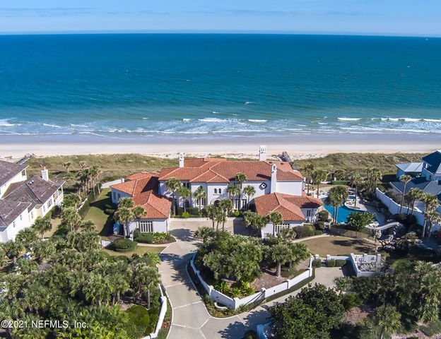 Remarkable, privately gated oceanfront oasis is situated high on the bluff w/ deep natural dune barrier. 223' of unparalleled views of the Atlantic. Excellent floor plan optimizes impact views from nearly every room. Concrete block construction with astonishing attention to detail & craftsmanship throughout. Elegant design touches by award-winning designers create light/bright, timeless appeal. 1st floor owner's suite w/ nearby stately library. Gourmet kitchen opens to family room. Gym/flex rooms. Outstanding outdoor living includes spectacular resort-style sparkling pool w/ slide, rock cave & waterfall. Covered lanai w/ summer kitchen is ideal for entertaining. Meticulously maintained. 4 car garage. Excellent location, just 1 mi. S. of Mickler's Landing & minutes to 5 star PV Inn & Club!