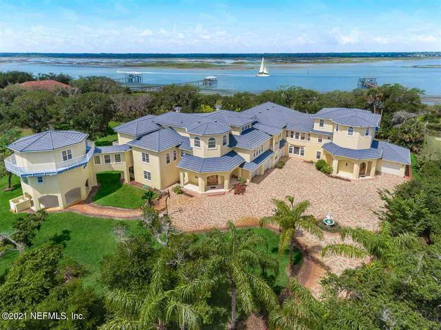 This exquisite waterfront estate was built in 2007 with energy efficient ICF construction. Set on 1.5 acres of pristine Intracoastal front land on Anastasia Island, this stunning home is surrounded by grand old Florida beauty. Thoughtfully designed, views of the Intracoastal waterway can be seen from most every room. Home amenities include two elevators, a home theatre, gym, sauna and 2300 sq ft guest suite. Two additional 1 acre lots available for a potential to own over 3.5 acres.