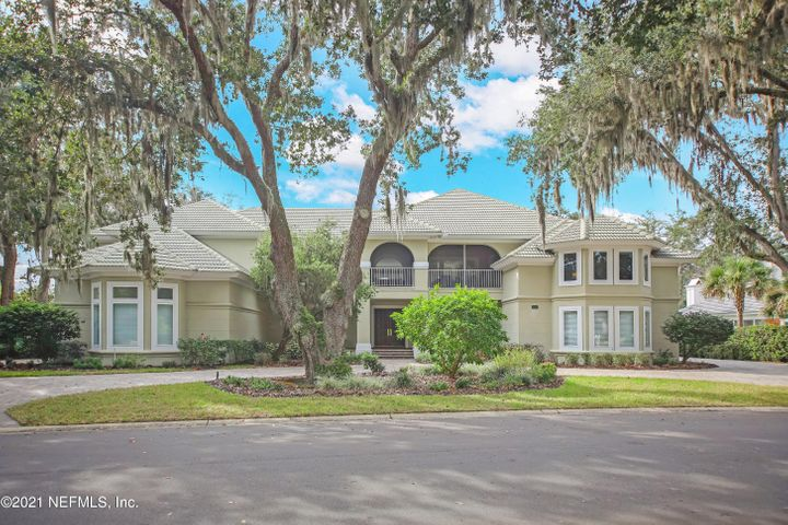 This magnificent Harbour Island estate home boasts 140 feet of Intracoastal Waterway frontage and unobstructed views of water, beauty and nature. An elegant, traditional floor plan features a sweeping floating staircase and lovely living room with a soaring 2 story ceiling and amazing views over the pool to the ICW. Perfect for entertaining, the spacious formal dining room opens to the foyer, living room, kitchen and a large wet bar and wine closet. Thoughtfully designed with 5 bedrooms (including 2 master suites - one upstairs and one down), the split floor plan has two en-suite bedrooms and a family room upstairs on the south side and two private studies and a reception area on the north side. A guest suite downstairs is perfect for in-laws or a nanny. The outdoor living spaces are stunning with a large screened balcony overlooking the lagoon where the 60' floating boat slip awaits. A huge screened porch with a summer kitchen faces the ICW and opens to the recently updated swimming pool. This custom home includes loads of storage space, 4 garage bays and circular driveway. The private boat slip is right across the street affording quick access to deep water boating.